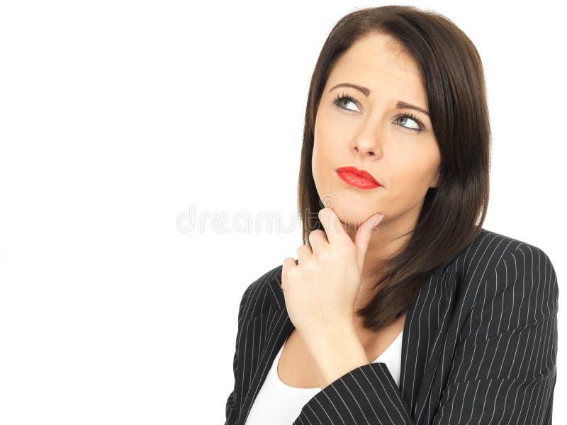 Nadenkende van Bedrijfs conerned Jonge Vrouw stock afbeelding