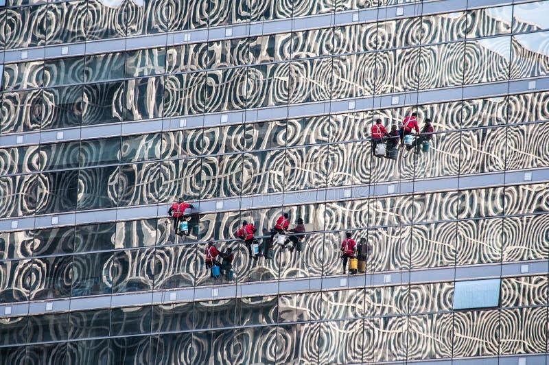 Nadokienni czyściciele w Pekin, Chiny zdjęcie royalty free