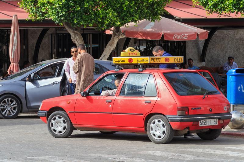 NADOR, MOROCCO - MAY 22, 2017: Local small red taxi car in center of Nador. Such cars are used in Morocco to move passengers. Within the city limits stock images