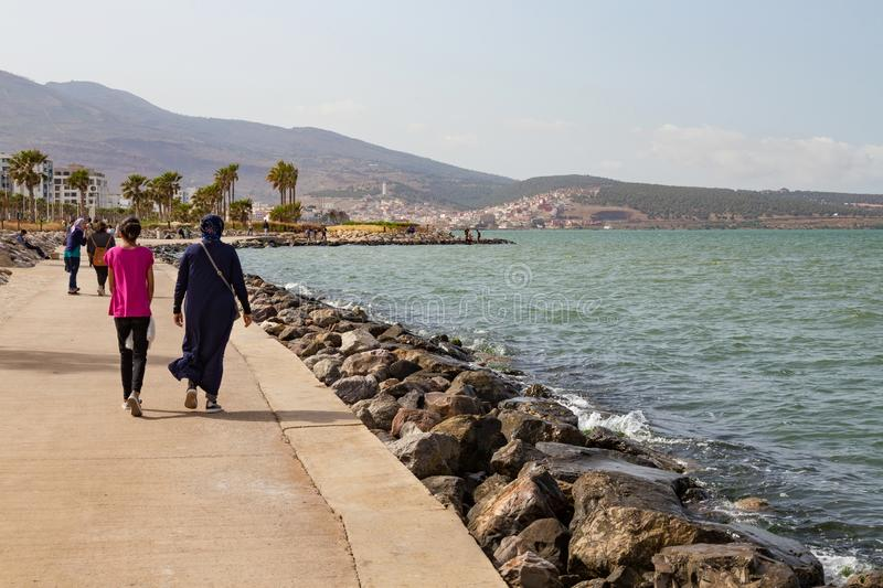 NADOR, MOROCCO - MAY 22, 2017: Walking people in the coast in Nador. Is a coastal city in the northeastern Rif region in Morocco. It is separated from the royalty free stock image
