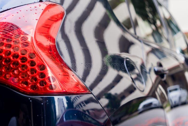 Nadrukclose-up van Auto achter lichte zwarte kleur royalty-vrije stock afbeeldingen