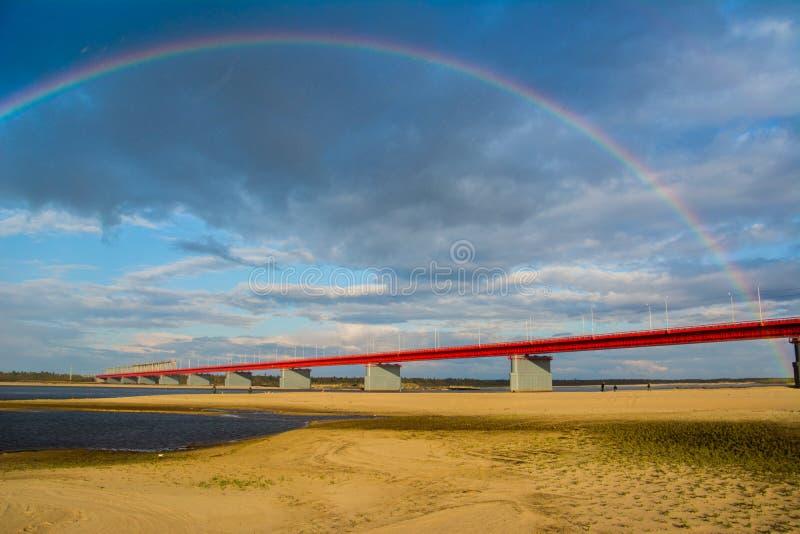 Nadym bridge and rainbow royalty free stock photo