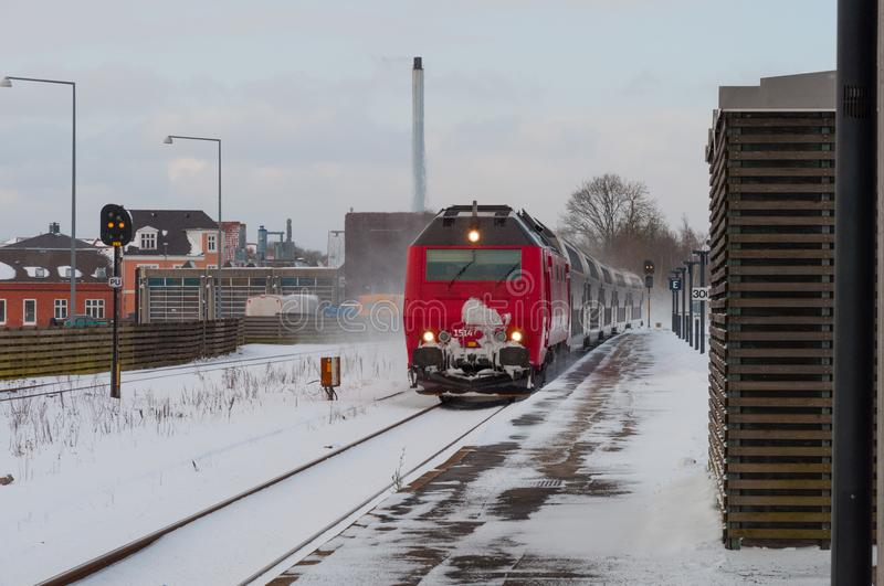 DSB ME locomotive arrives with a regional train to Naestved train station stock photos