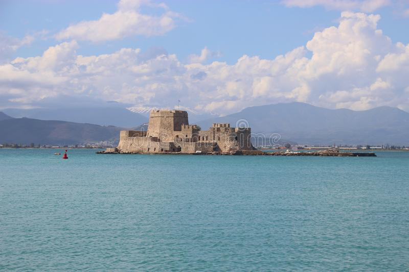 Nafplio, Peloponnese, Greece. Bourtzi castle and mountain landscape in pastel colors. royalty free stock photography