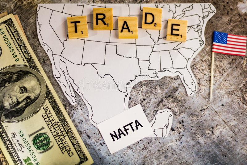 NAFTA trade business concept suggesting border wall on Mexico. With map of United States and Mexico stock image
