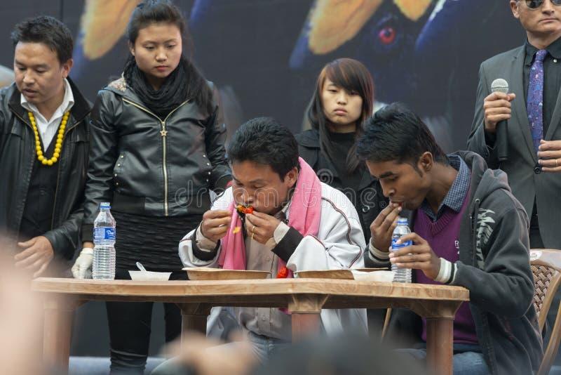 Naga Cilli eating competetion at Hornbill festival,Kohima,Nagaland,India on 1st December 2013. Asia stock photography