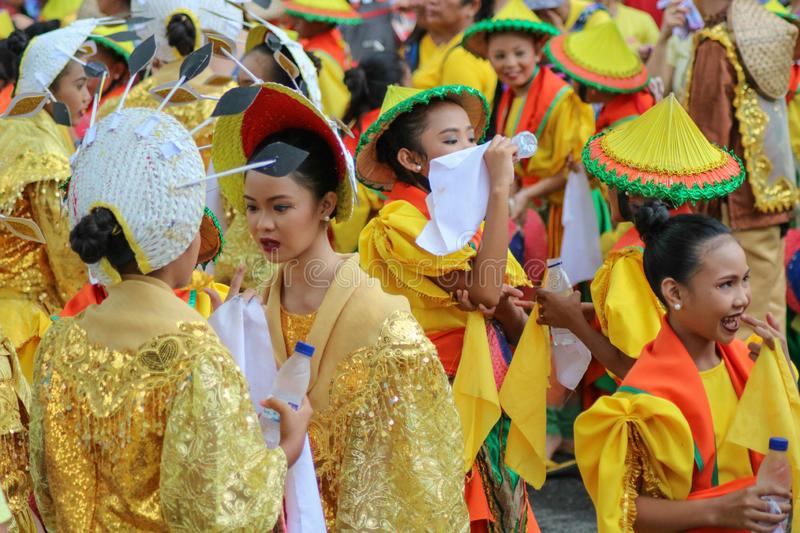 Street dancing participants wearing colorful costumes. NAGA CITY, CAMARINES SUR / PHILIPPINES - SEPTEMBER 13, 2018: Street dancing participants wearing colorful royalty free stock images