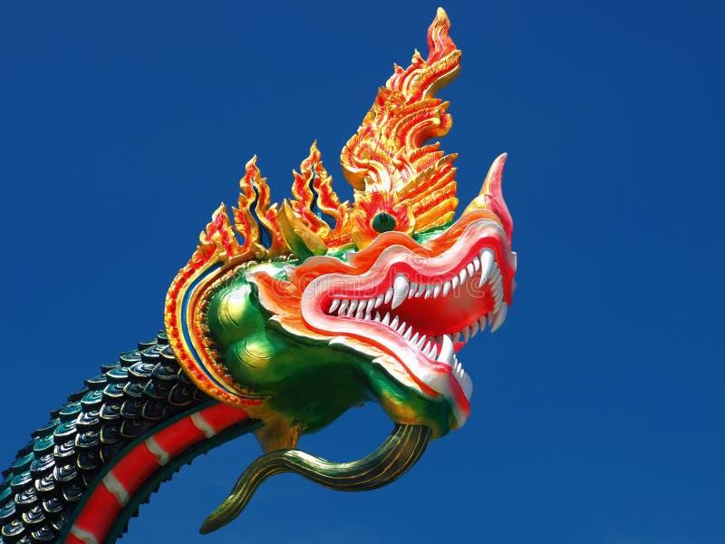 Naga soaring into blue sky royalty free stock photo