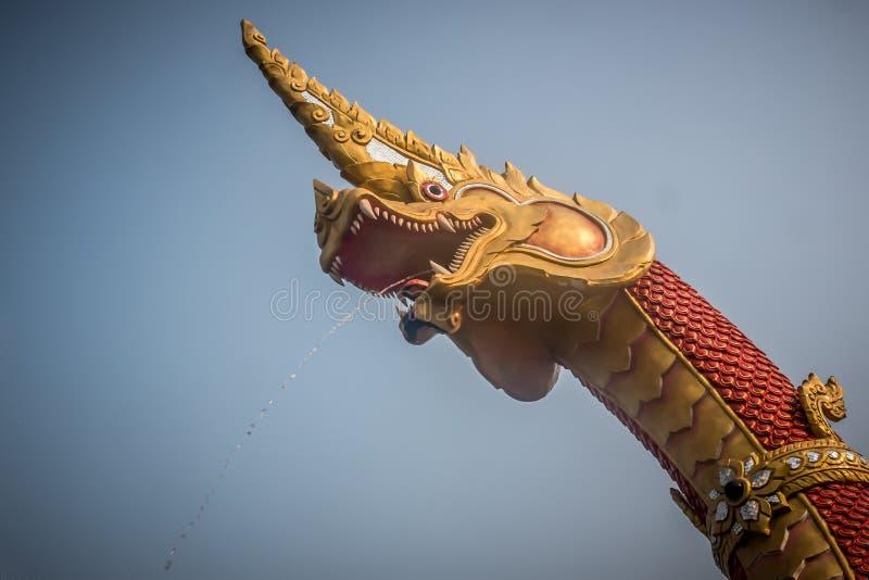 Naga spraying water. Spirit of Thailand royalty free stock photo