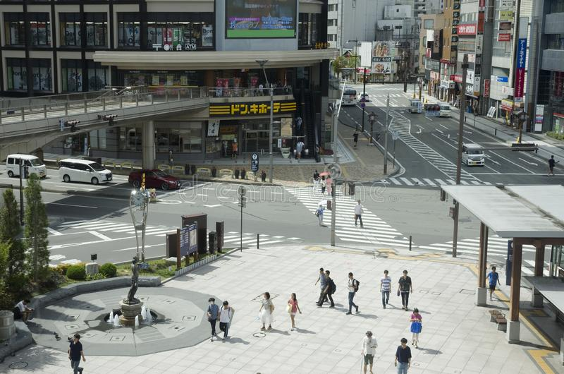 Nagano city, Japan. Center of Japanese city Nagano in fron of JR railway station with people coming around royalty free stock photo