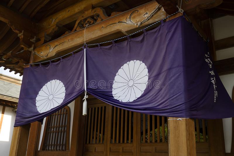 Nagano - Japan, June 3, 2017: Purple temple curtain with a white. Knot at the Buddhist Zenkoji temple in Nagano royalty free stock photo
