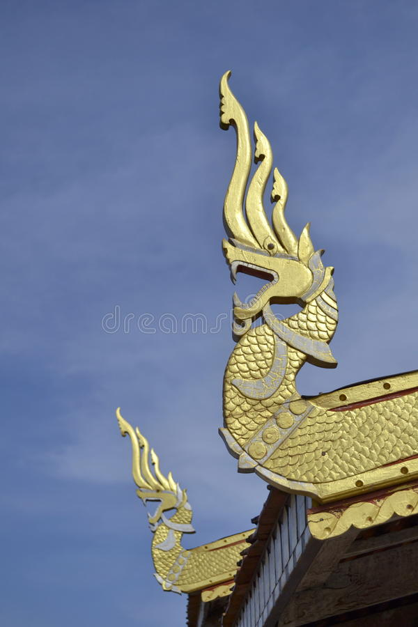Nagas : wood carved on the roof.Wat Si Po Chai,Na Haeo District,Loei Province,Thailand. Wat Si Po Chai is locatedeven closer to the border country with Laos stock photography