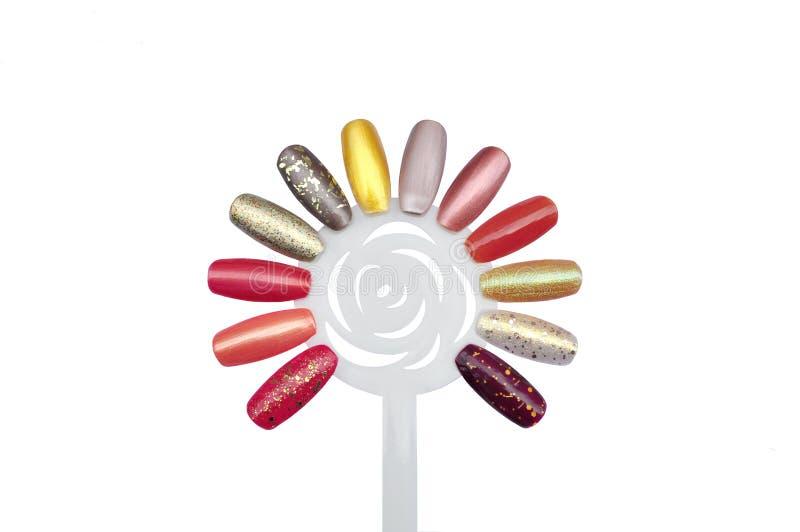 Nagellackproben lokalisiert auf der Weiß-, Herbst- oder Fallfarbe blaß stockbilder