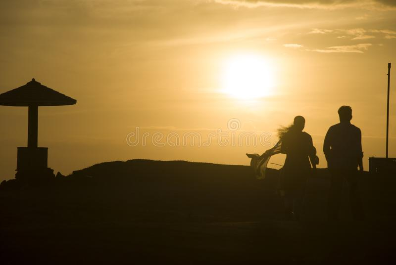 Indian couple in Nagercoil during sunset. Nagercoil, Tamil Nadu, India - October 16, 2010: Indian Couple walks in the seashore of Nagercoil at sunset. The Beach stock image