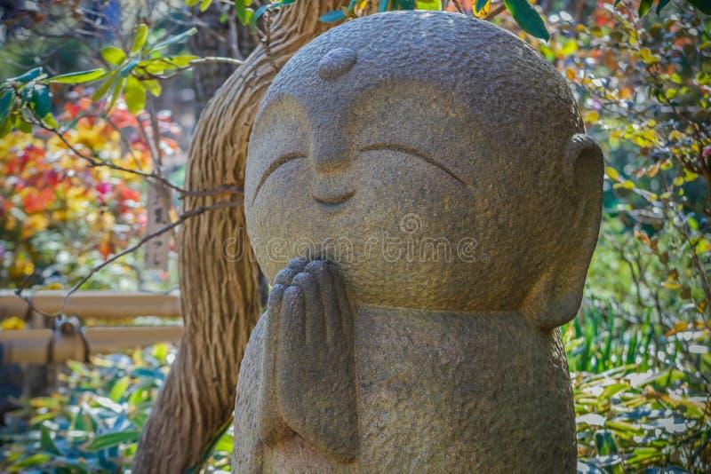 Nagomi Jizo At Hase-dera Temple in kamakura. Happy smiling Nagomi Jizo placed in a garden of Hase-dera temple royalty free stock image
