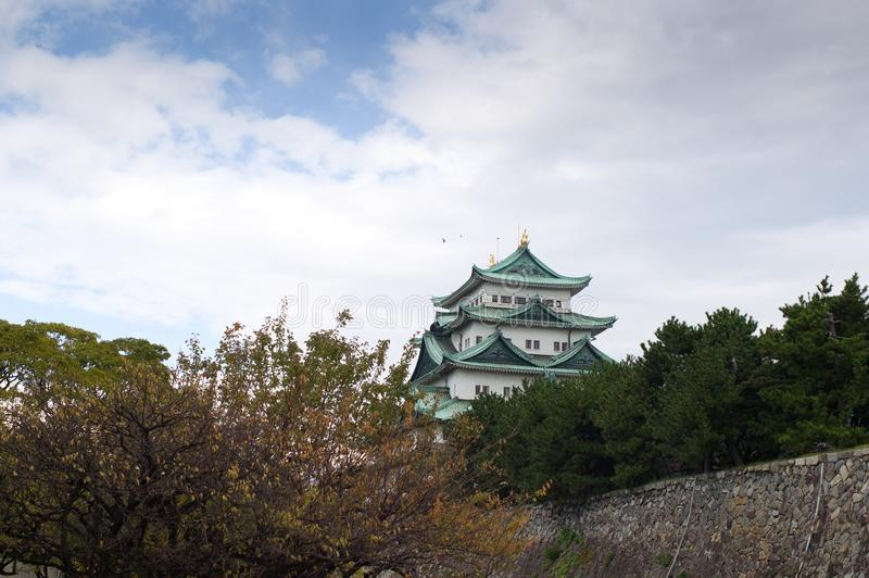 Nagoya Castle in Nagoya, Japan. Nagoya Castle in autumn with plum trees in the foreground stock image