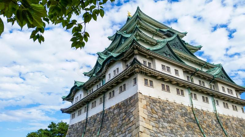 Nagoya Castle in Japan. Building and Attraction landmarks concept. Travel around the world theme. Cloudy, sky, flower, japanese, white, tourism, ancient royalty free stock photo