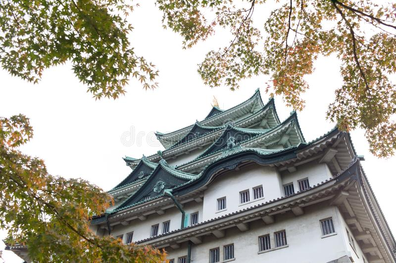 Nagoya Castle in Nagoya, Japan. In autumn with foliage leaves in the foreground royalty free stock photos