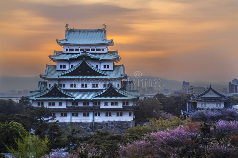 Nagoya Castle in Nagoya, Japan. At sunrise with red and yellow sky stock photography