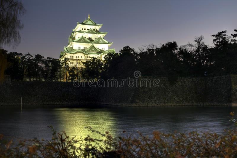 Nagoya Castle at night, Japan. Night scene of the main keep of Nagoya Castle overlooking the extensive moat around it during a winter night. Nagoya Castle was royalty free stock image