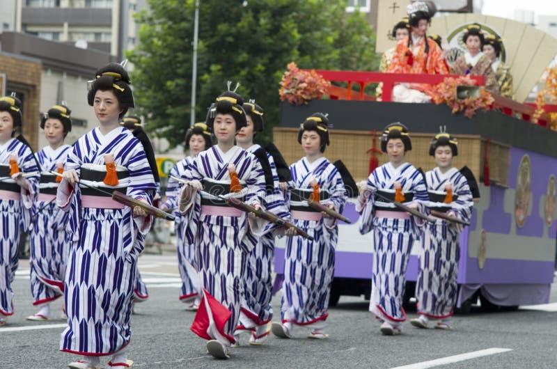 Nagoya Festival Parade, Japan. Maiko with parasols in traditional feudal costume at 62nd Nagoya Matsuri Festival, Japan stock images
