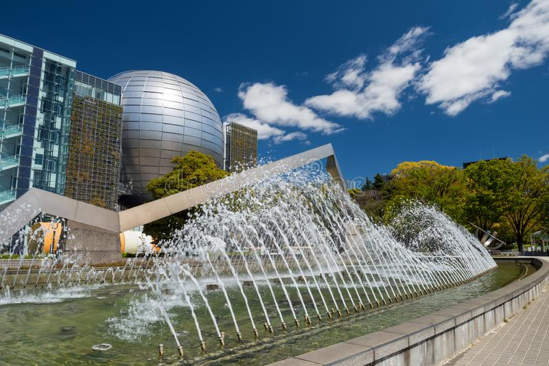 Science museum park in Nagoya. Nagoya, Japan - April  2019: fountain show at park of Nagoya science museum building architecture against blue sky in Aichi stock photos
