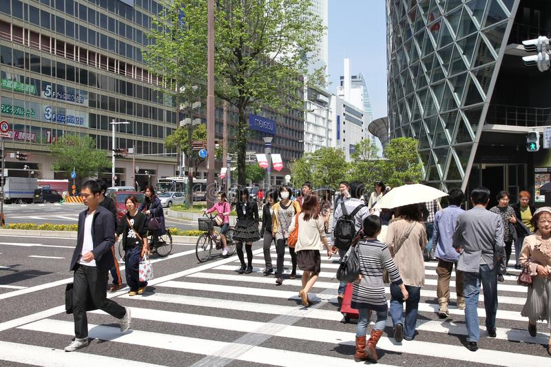 Nagoya, Japan. APRIL 29, 2012: People walk in downtown . With almost 9 million people Nagoya is the 3rd largest metropolitan area in Japan stock images