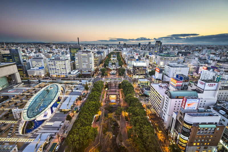 Nagoya, Japan Cityscape. NAGOYA, JAPAN - NOVEMBER 27, 2012: Twilight over Hisaya Odori Park in the Sakae District. The park is at the heart of the city and its stock photography