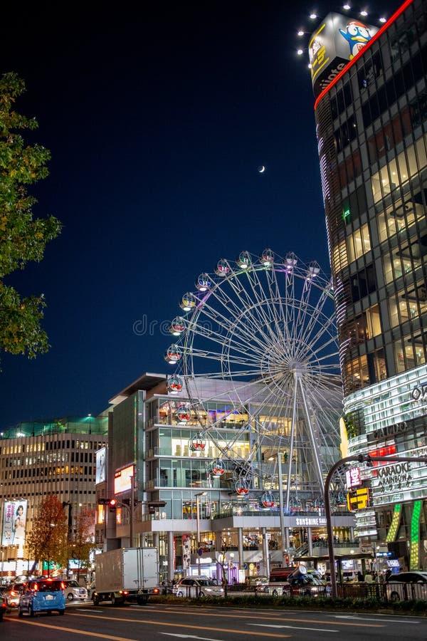 Advertisement and logos in Sakae cross Shopping Center. Nagoya Japan - December 2018 : Sunshine Sakae Shopping Centre and Ferris wheel opposite to donkihote mall royalty free stock photo