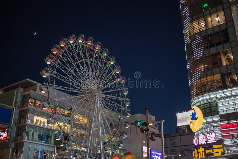 Advertisement and logos in Sakae cross Shopping Center. Nagoya Japan - December 2018 : Sunshine Sakae Shopping Centre and Ferris wheel opposite to donkihote mall stock images