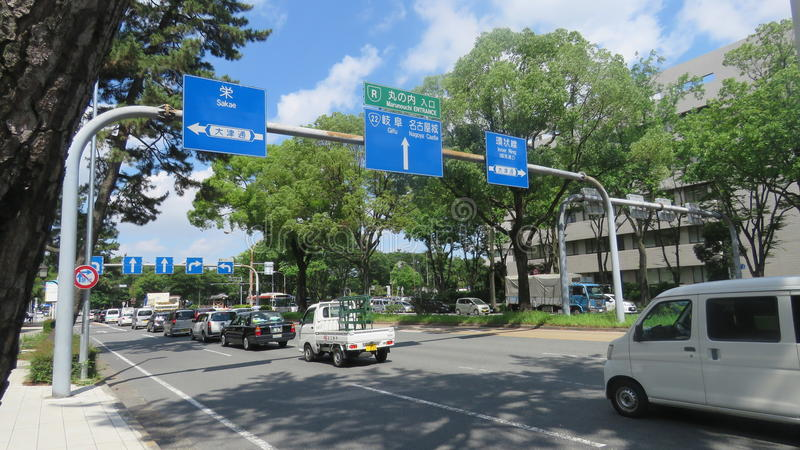 Nagoya street with roadsigns to castle stock photo