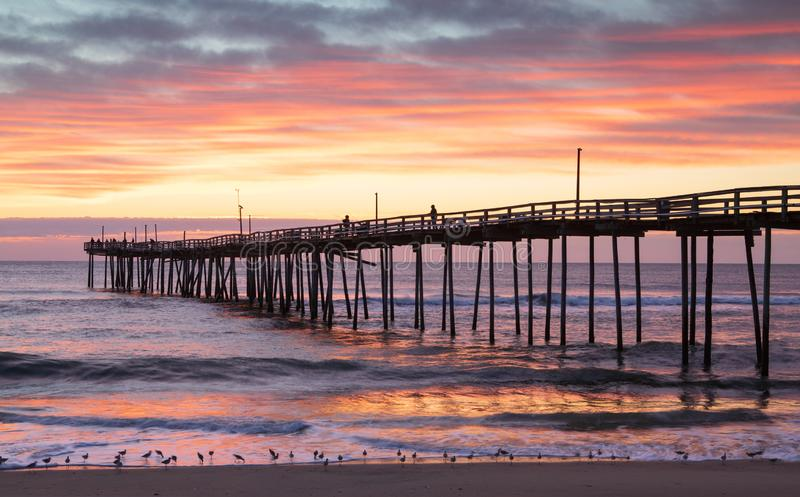 Nags Head North Carolina Fishing Pier Sunrise. Sunrise over the Nags Head Fishing Pier and Atlantic Ocean on the Outer Banks in North Carolina stock images
