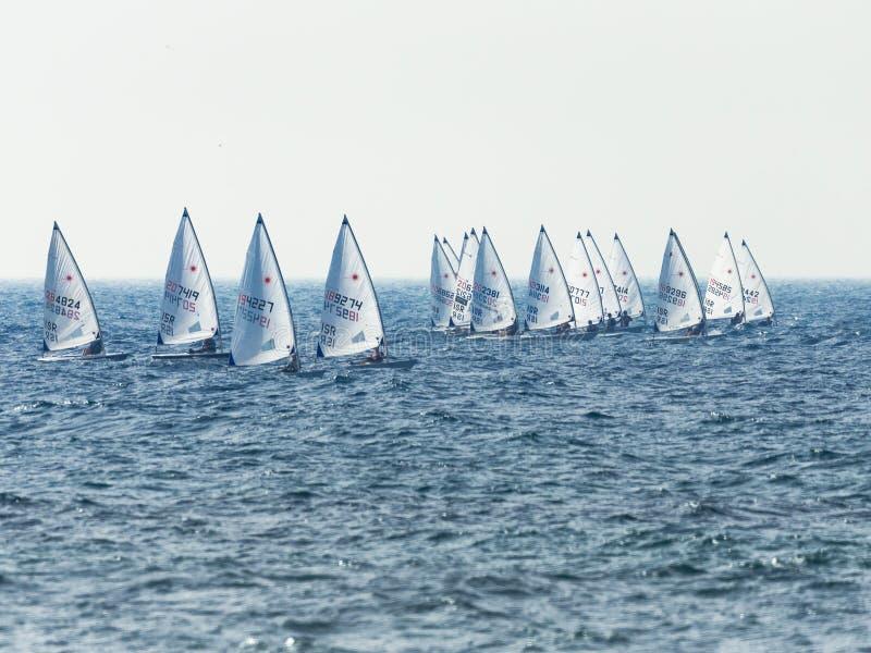 A group of sportsmans on small sailing yachts trains on the Mediterranean Sea near the coast of Nahariyya in Israel. Nahariyya, Israel - Februar 10, 2018 : A stock photography