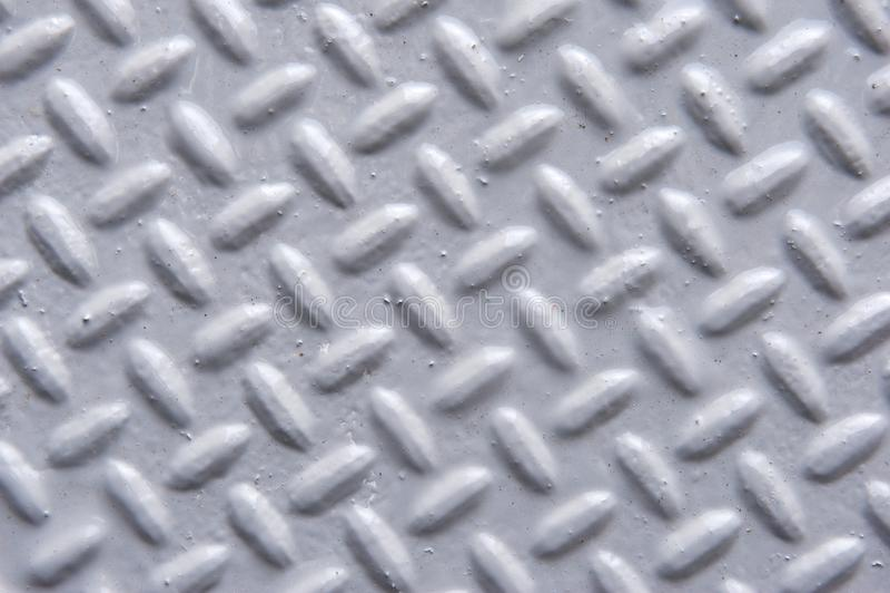 Nahaufnahme der gemalten Metalloberfläche mit Fischgrätenmuster-Muster lizenzfreie stockfotografie