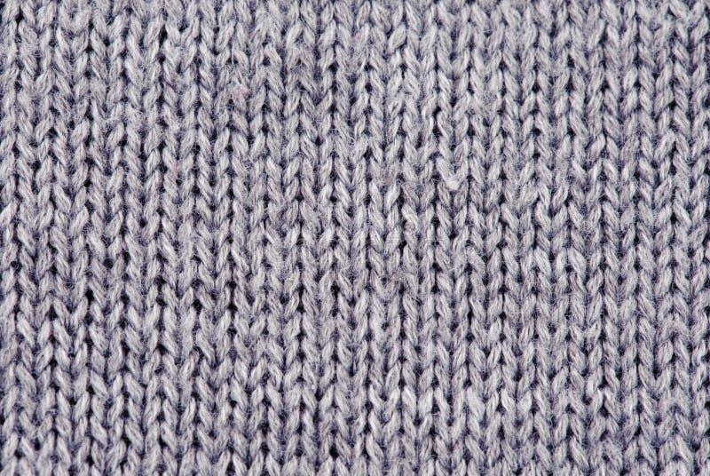 Nahaufnahme der gestrickten Wollebeschaffenheit lizenzfreie stockbilder