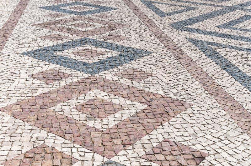 Nahaufnahme der portugiesischen typischen Pflasterung, calcada stockfotos