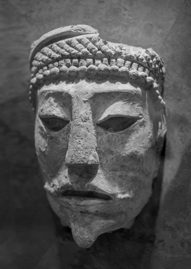 Nahaufnahme der Steinhauptmaske, die von Comalcalco, Tabasco, Mexiko, Mayazivilisation entsteht stockfotos