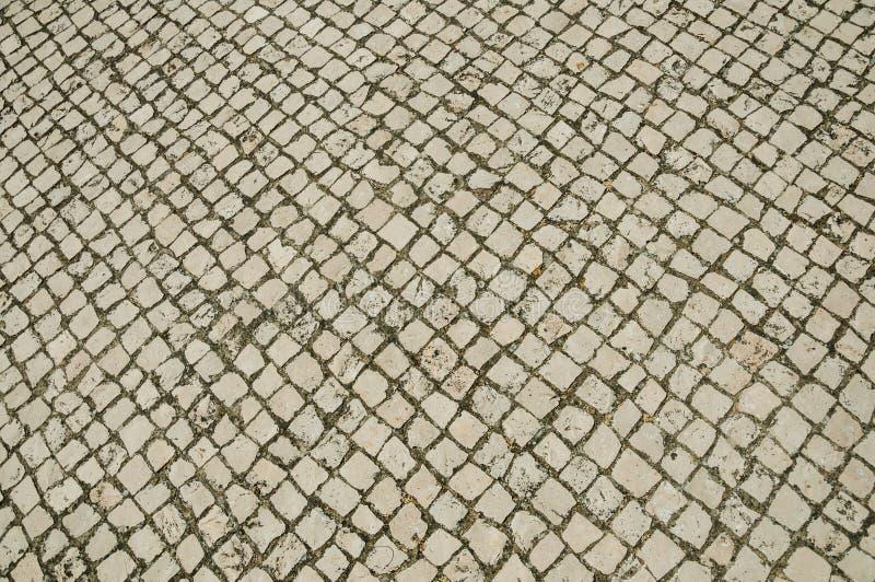 Nahaufnahme der wei?en Steinpflasterung in der quadratischen Form lizenzfreies stockfoto