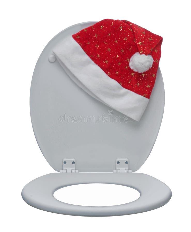 Nahaufnahme der weißen Toilettenschüssel und des Santa Claus-Hutes stockfoto