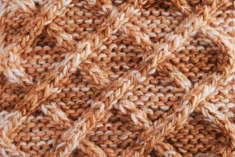 Nahaufnahme des gestrickten Tuches mit geometrischem Muster lizenzfreies stockbild