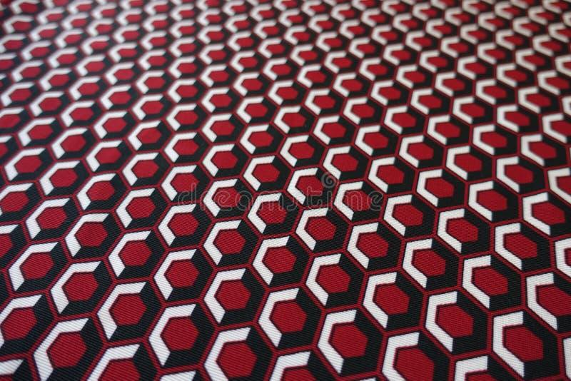 Nahaufnahme des hellen Hexagondruckes auf Gewebe lizenzfreie stockfotografie