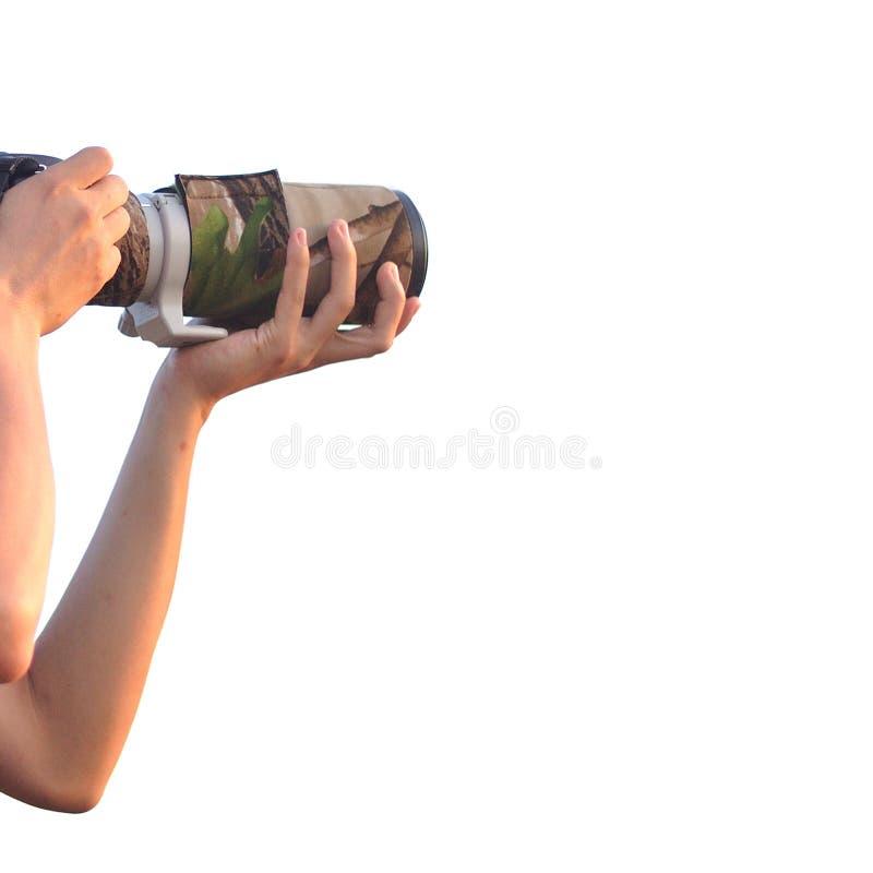 Nahaufnahme des Mannes Digitalkamera mit dem Linsenzoom halten lokalisiert auf weißem Hintergrund stockfotografie