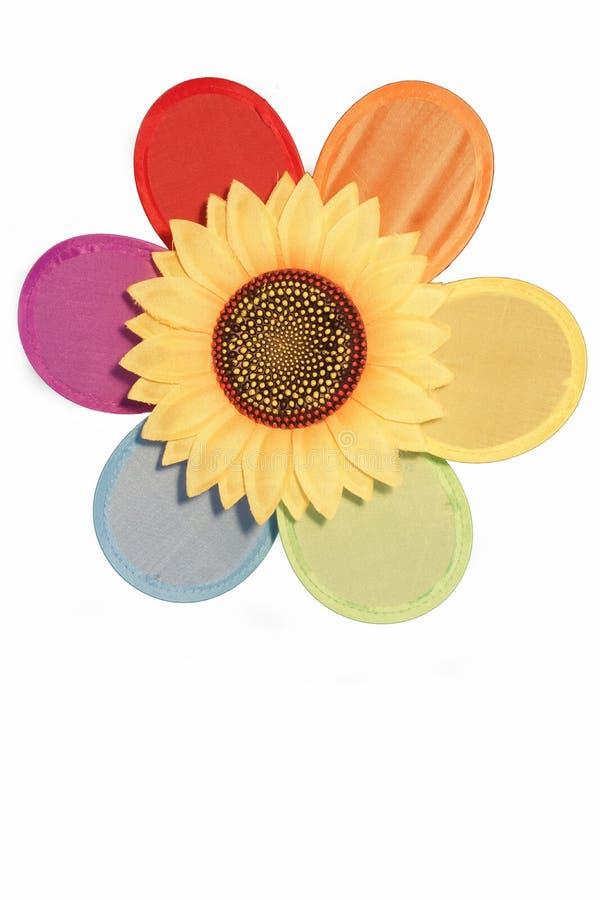 Nahaufnahme des Regenbogen-Gewebe-Feuerrads mit Plastiksonnenblume Isola lizenzfreies stockfoto
