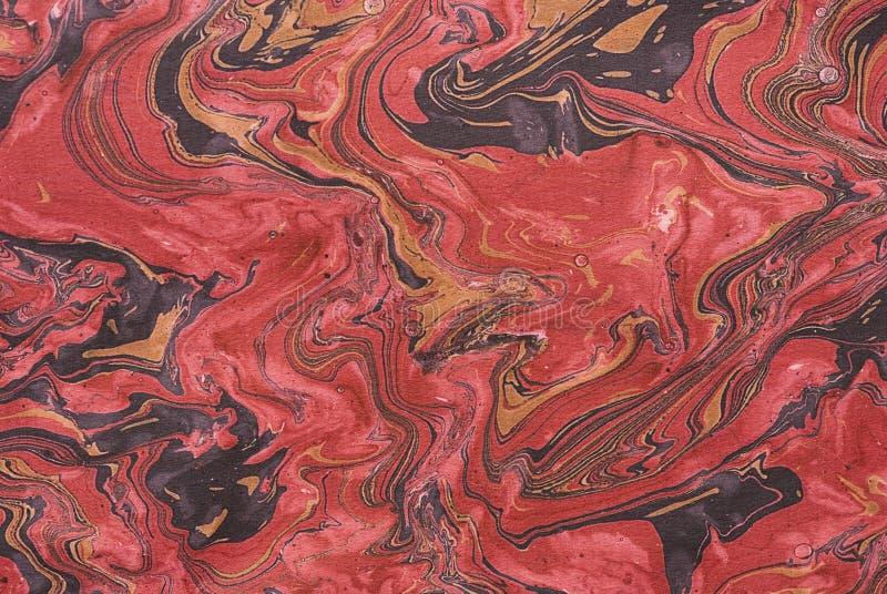 Nahaufnahme des roten marbleized Papiers lizenzfreies stockbild