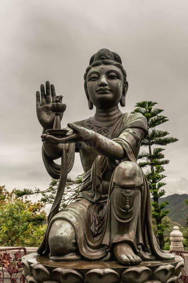 Nahaufnahme, eine des sechs Devas, das Tian Tan Buddha, Hong Kong China anbietet stockfotos