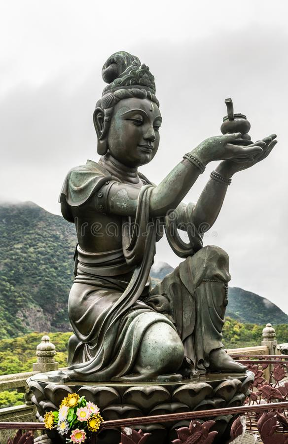 Nahaufnahme, eine des sechs Devas, das Tian Tan Buddha, Hong Kong China anbietet stockfoto