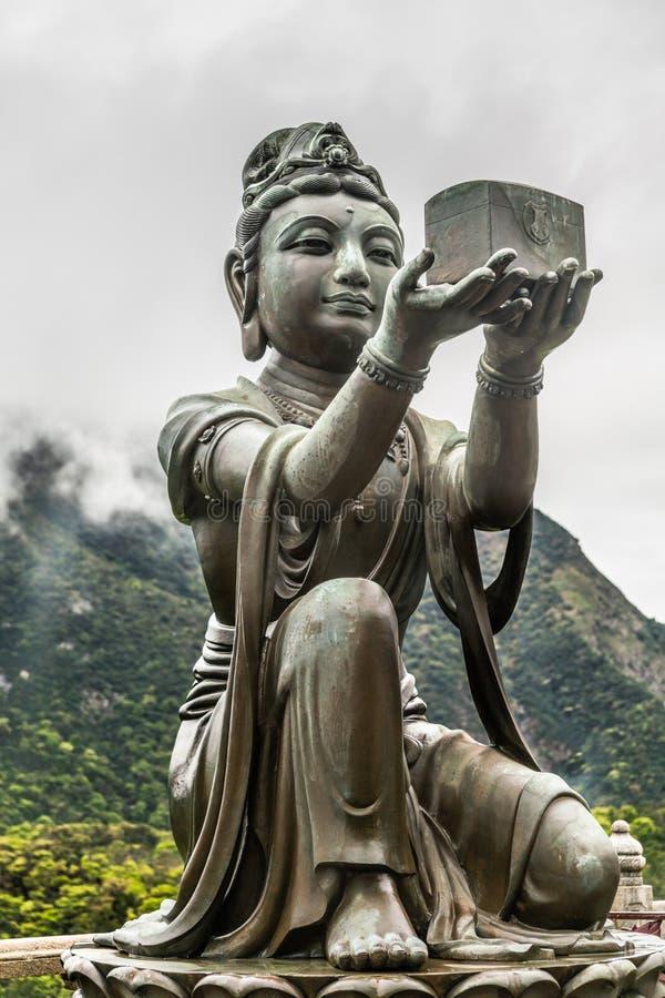 Nahaufnahme, eine des sechs Devas, das Tian Tan Buddha, Hong Kong China anbietet stockbilder