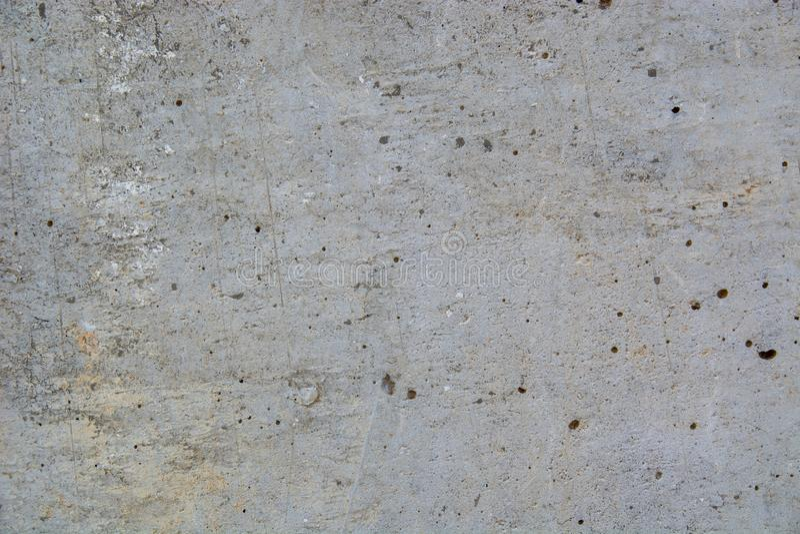 Nahaufnahme einer schädigenden grungy Marmorwand mit kleinen Löchern stockfotos