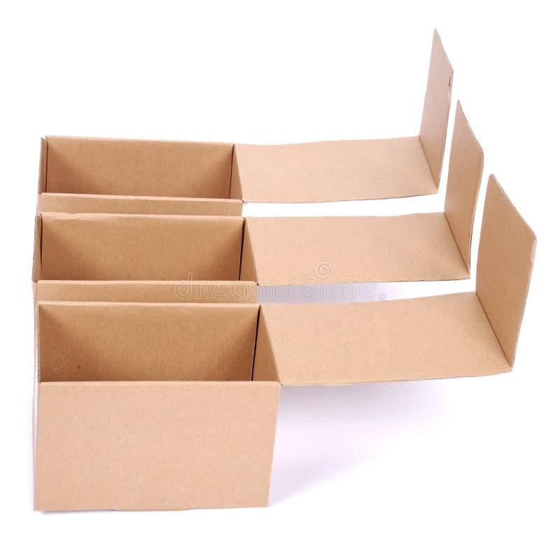 Nahaufnahme von drei offenen Pappschachteln stockbild