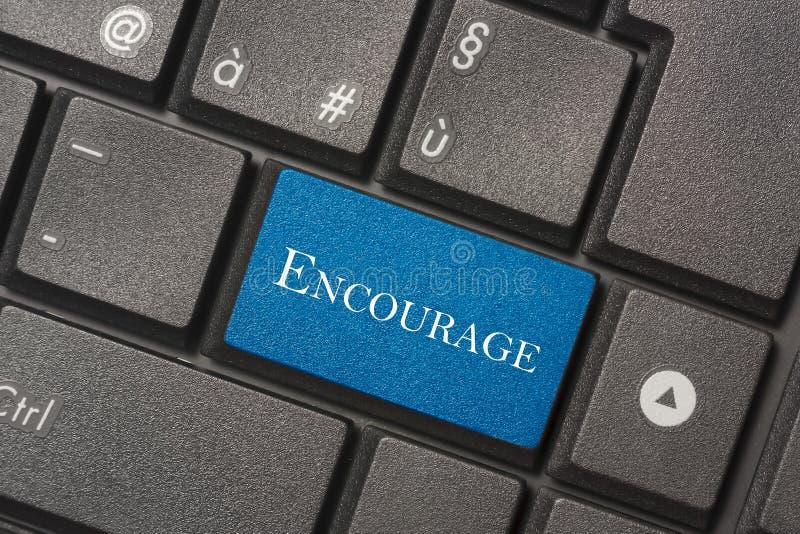 Nahaufnahmebild von Encourage Knopf der Tastatur eines modernen Computers lizenzfreies stockbild